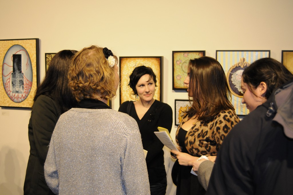 KAC Gallery visitors discuss an art exhibition
