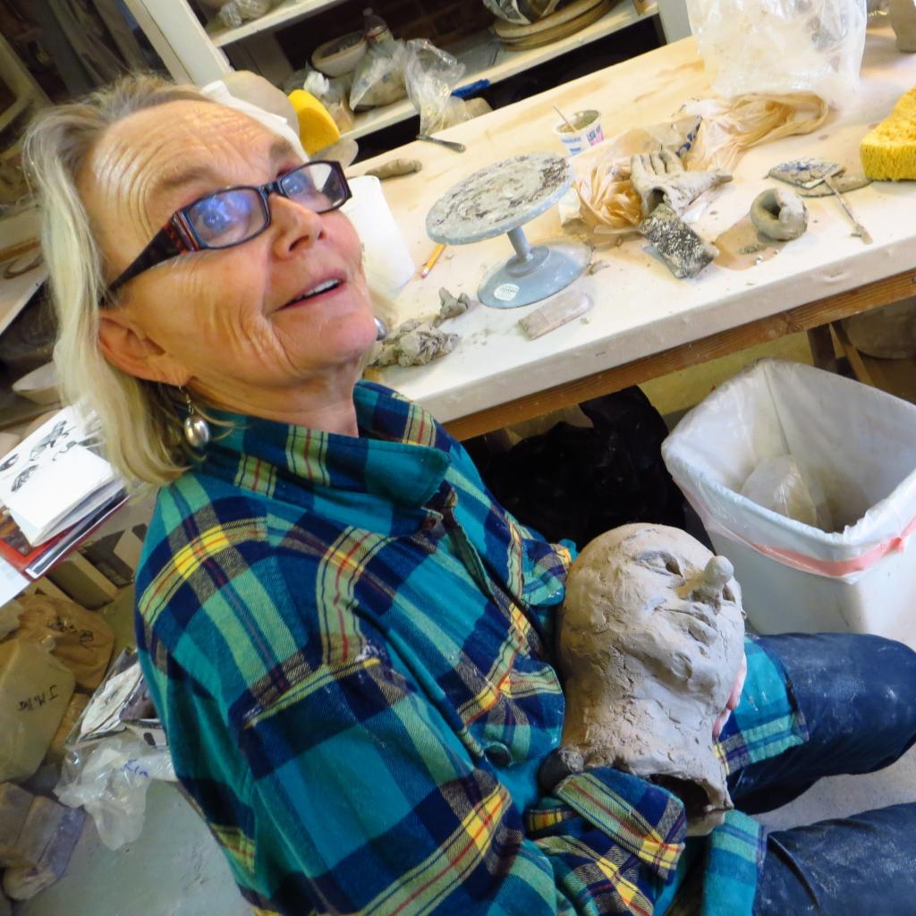 Donna Porter sculpts ceramic head in Building Big Workshop, photo credit Adrian Rembold