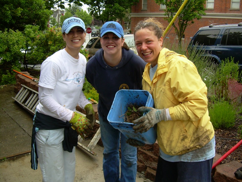 Volunteers assist by pulling weeds during a fun work day.